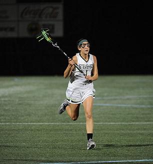 Carli Bafford charges up the field. (Photo by Sabina Moran)